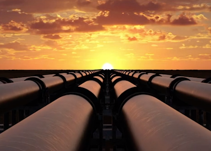 pipelines on a horizon with the sun rising